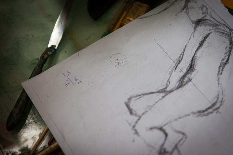 Lennart Anderson studio interior close up of a figure drawing with palette knife to the left